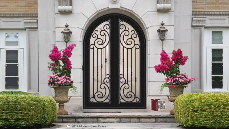 Transitional Style Front Doors: Arched Paris Double Door, modern double door, metal doors, with hand sculpted faceted pulls and ornate collars handcrafted by pivot doors company Modern Steel Doors in Arizona, USA.